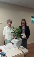Jill Storey, Gosport WI's new President presents Carolyn Kilbey (retiring President) with a WI Rose.