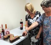 President Trish and committee member Ali cutting our second birthday cake