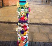 Abbotswood Romsey WI 2018 yarn bombed bollard cover